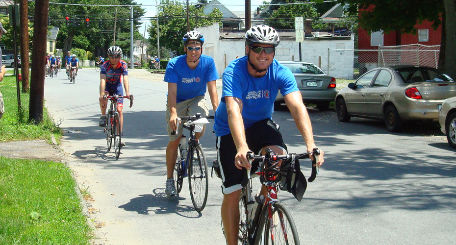 Bike and Build volunteers cruise into downtown Poughkeepsie to help raise awareness of affordable housing