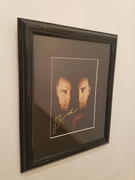 Face Off signed by John Travolta and Nicolas Cage
