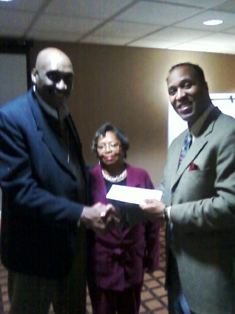 James and Linda receive Check