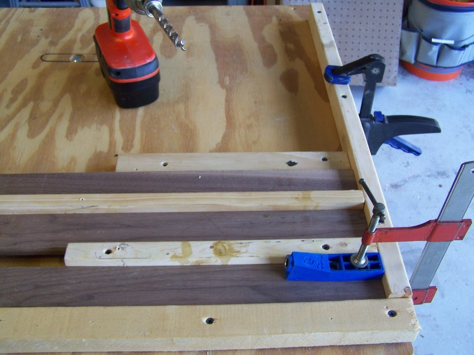 The jig I made to drill three boards at the same time.