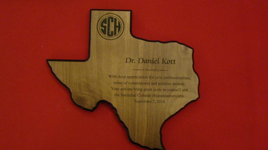 Dr. Kott receives plaque
