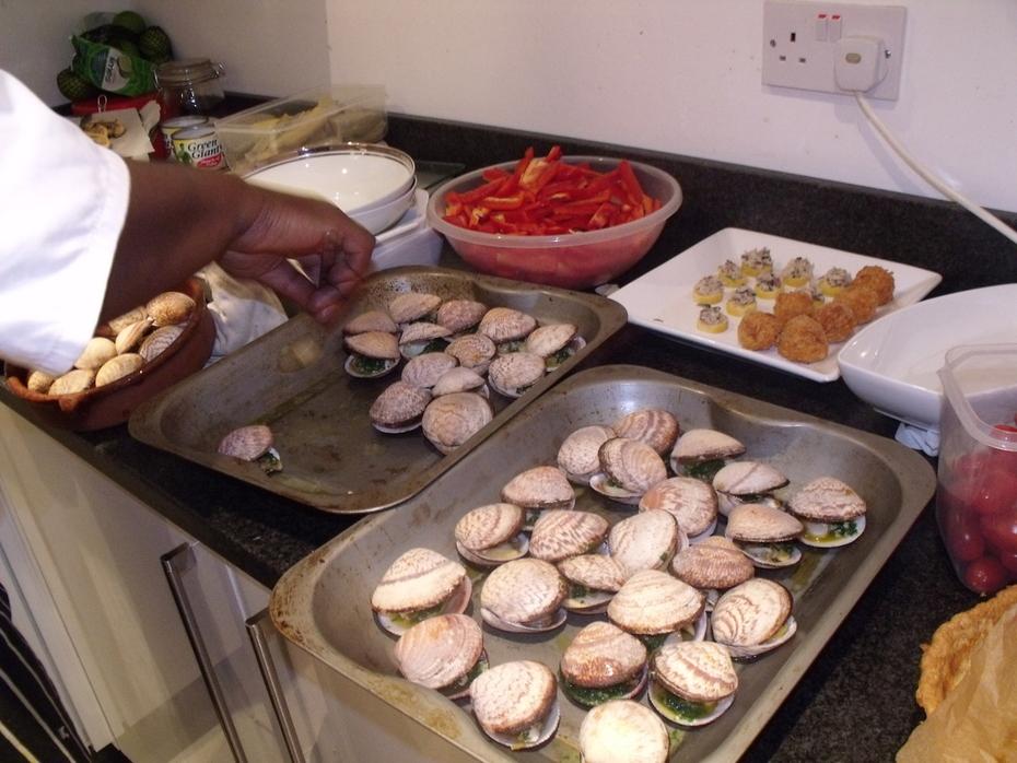 Chef Ben preparing the clams