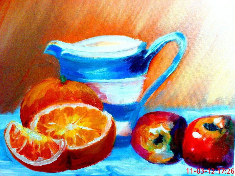 Oranges with cup and aples