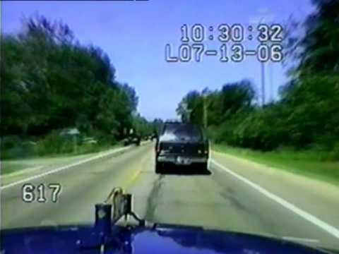 Cops smash SUV off the road