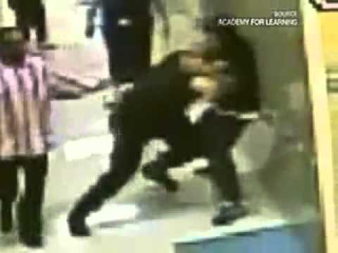 Police Brutality - Officer Beats Special Ed Kid