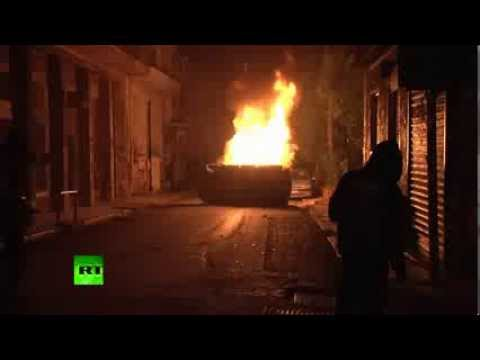 Cops, cars on fire as protesters throw Molotov cocktails in Athens