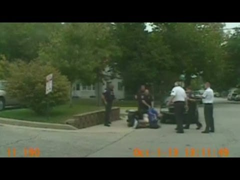 Shocking CCTV: Police officer pushes over man in wheelchair