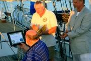 Captain Ray awarding Butch a Certificate of Appreciation