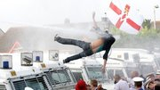 loyalistprotestorblownawaybypsniwatercannon