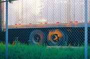 semi behind gate