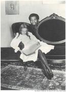Kareem Abdul-Jabbar Hides behind Girl Sitting on Couch
