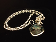 sterling silver necklace with decorative glass pendant
