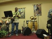 Cedric James preparing for worship service