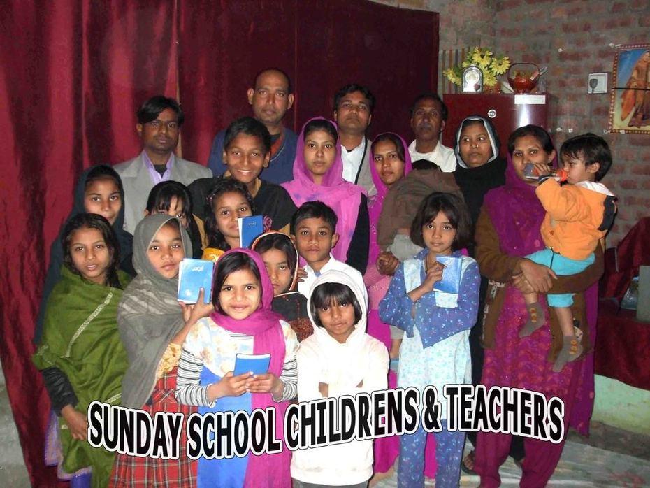 Sunday School teacher and children