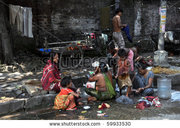 stock-photo-kolkata-india-october-local-people-wash-themselves-on-the-street-of-kolkata-on-october-59933530