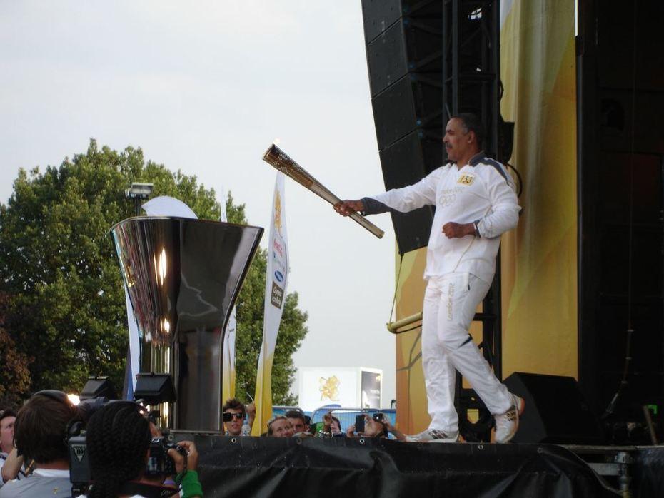 Daley Thompson lighting the cauldron Haringey Olympic Torch Relay Celebrations, Ally Pally