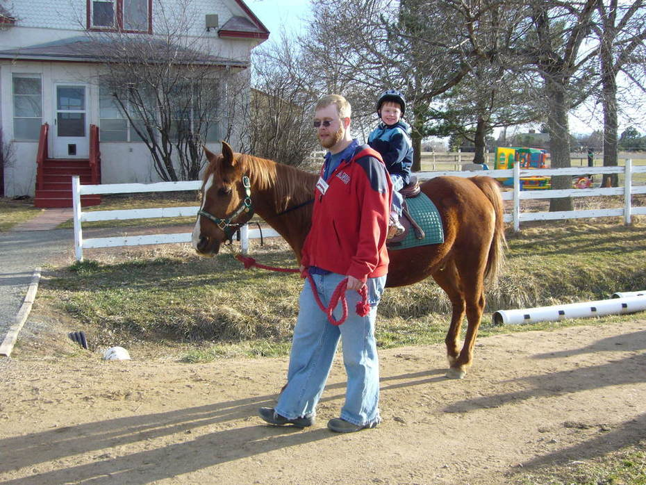 Therapeutic riding with James and little lakota
