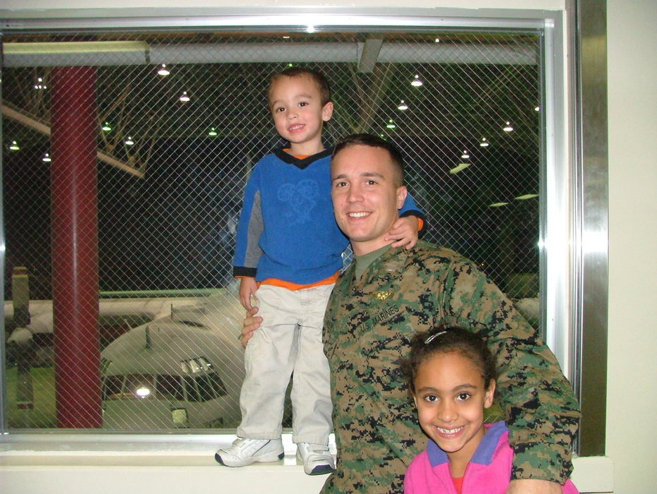Chloe and Elijah at work with Dad
