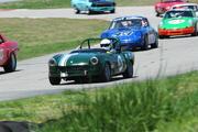 """64 Spitfire: """"Outta my way Porsches!"""""""