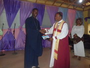 My father,his lordship giving me a certificate of recognition.
