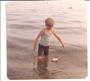 1974 - Jeff - Cape Cod in water with favorite lobster boat