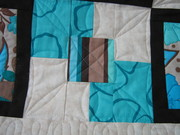 Teal and brown quilt