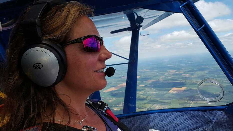 Robin, Our Daughter, Flying her  Zenith 701, in Michigan