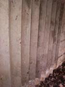 Concrete concertina bullet deflector panel.