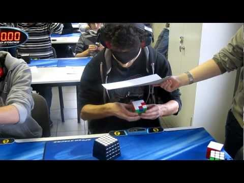 Young man crushes blindfolded Rubik's Cube record