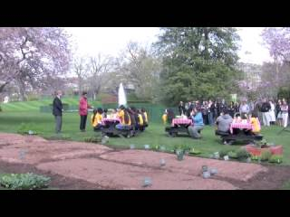 First Lady Michelle Obama plants a garden