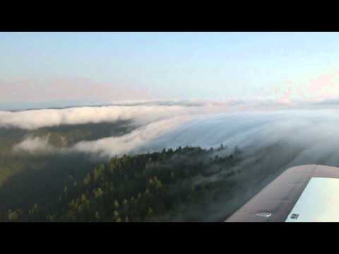 Pacific Ocean Fog Spills Into An Inland Valley.wmv