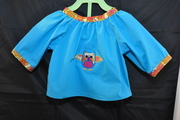 back of infant blouse with owl applique