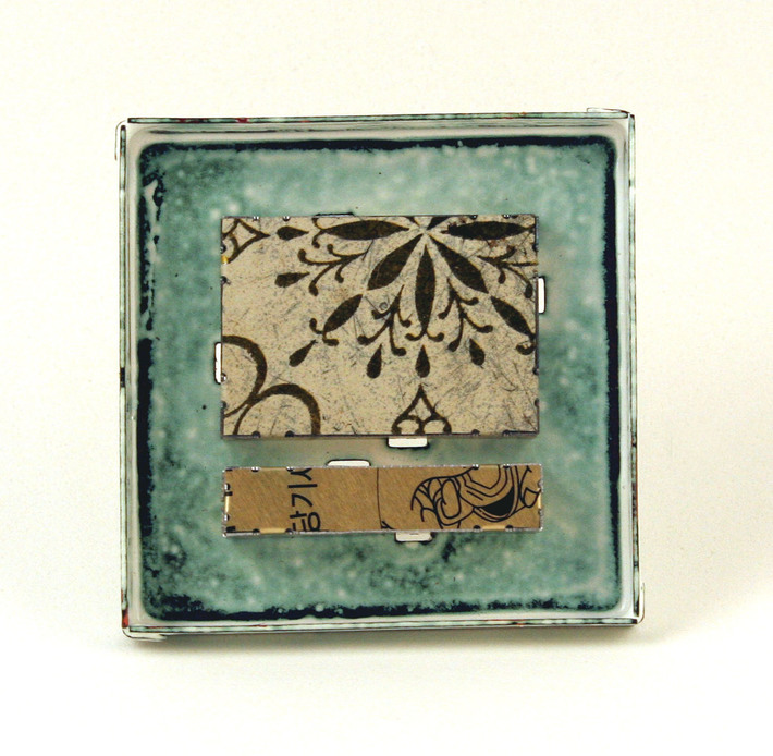 White & gold enamel & tin brooch