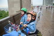 Boys on the bridge, biking the drive