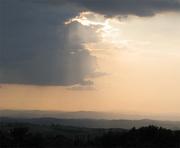 Sun, clouds, hills