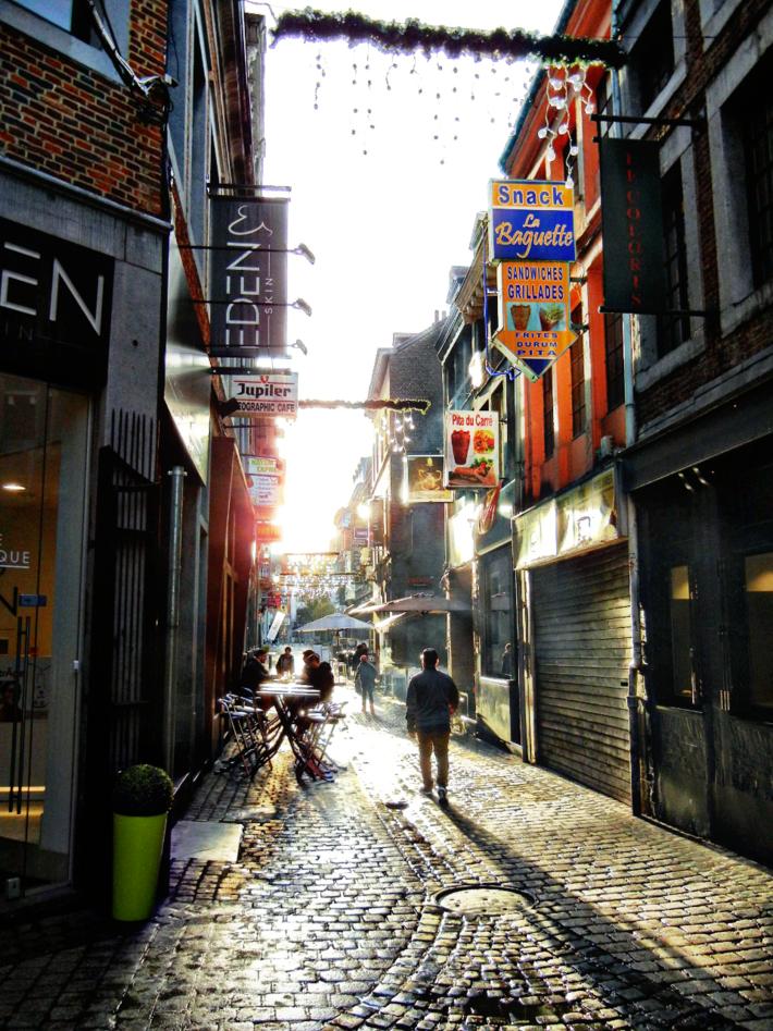 Small animated street of Liège, Belgium, November 2018