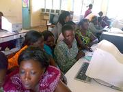 A teachers ICT class in session.note the dead monitors in the background
