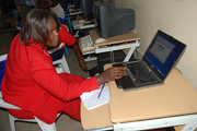 Dorothy working on laptop in Mbita