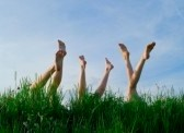 5639719-feet-of-girls-laying-and-sunbathing-in-a-grass-against-the-blue-summer-sky
