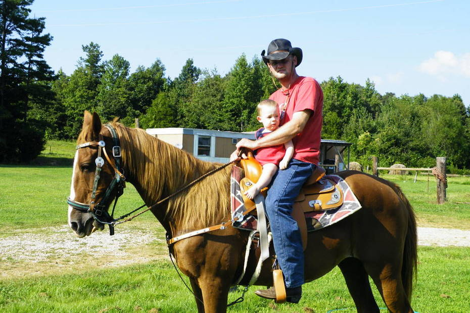Zach's first time on a horse riding daisy with chris