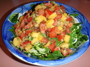 Chunky courgette pasta with spinach and tomato, mango, spring onion, date and avocado salsa