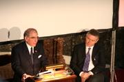 Foreign Minister De Ghucht listens to Ambassador Fox's speech