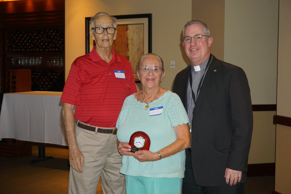Volunteers of the Year Eugene and Theresa Houghton with Father Philip Joly