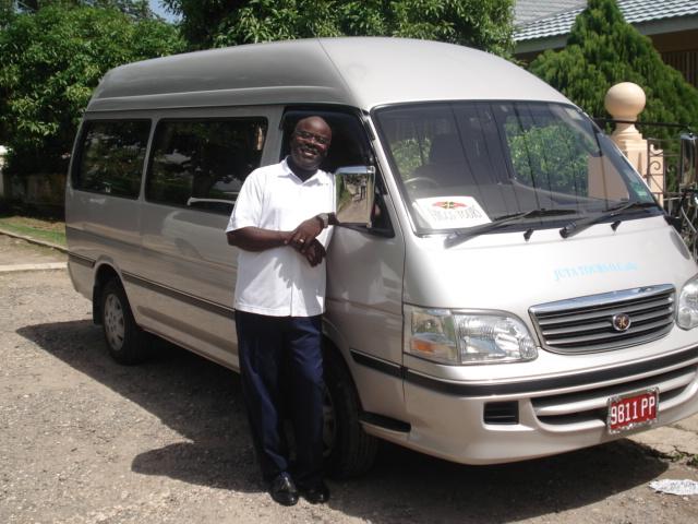 Noel Higgins with His Beautiful New 10 Passenger Van