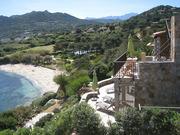 Ferienhaus und Blick auf Strand