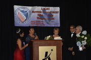 MECATX Queen presents Ms. Lotus award at LULAC Herencia Gala
