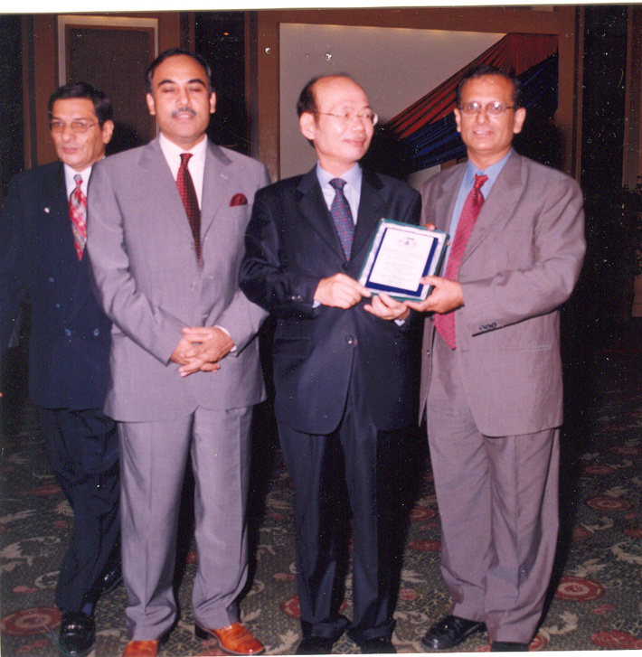 Master Zubairi Presents WOMA-USA Shield of Honour to Mr.Suk Chul Chang,Consul General at the ocassion  of National Day of Republic of Korea on 30 th Sep 2005.