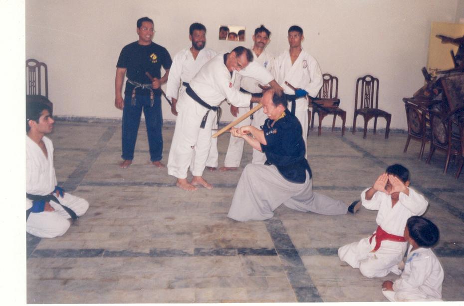 Grandmaster Kim Attack and Master Zubairi block during Kumdo Training session.May 2006