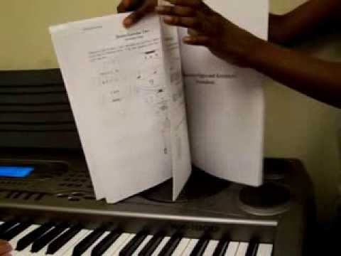 Turning the pages of the Rhythm and Notes workbook