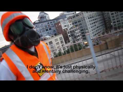 Anarchist On Brooklyn Bridge in Gasmask (The Interview)